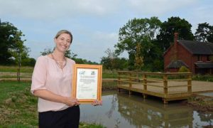 Network Rail CEEQUAL Assessor Lucie Anderton at Shallowford house, home to 6 new replacement ponds and a new community open space
