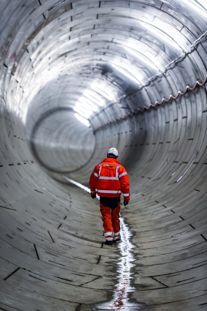A worker walks along the completed tunnel from Plumstead to North Woolwich
