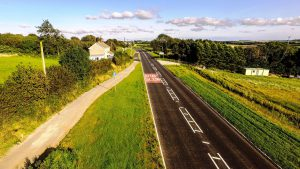 Part of the new offline section of road, with the original (narrow) Bulford Road retained as a shared footway and cycle route. Image: Alun Griffiths (Contractors) Ltd